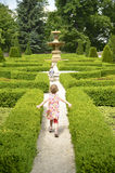 Happy children running through the maze Stock Photo