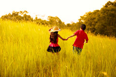 Happy children running at meadow Stock Images
