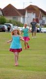 Happy children running Stock Photos