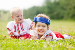 Happy children in russian folk clothes Stock Photography
