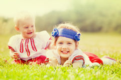 Happy children in russian folk clothes Royalty Free Stock Photos