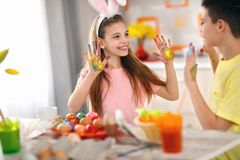 Children`s hands dirty from paint for eggs stock photos