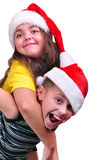 Happy children with Santa Claus red hats Royalty Free Stock Photography