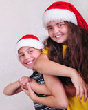 Happy children with Santa Claus red hats Stock Images