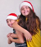 Happy children with Santa Claus red hats Royalty Free Stock Photo