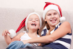 Happy children in santa hat Royalty Free Stock Photography
