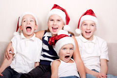 Happy children in santa hat Stock Photography
