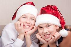 Happy children in santa hat Royalty Free Stock Image
