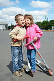 Happy children with scooter Royalty Free Stock Photography