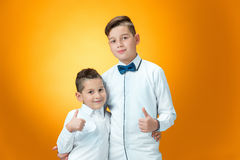 Happy children showing thumbs up sign OK Royalty Free Stock Images