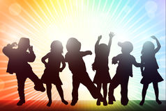 Happy children silhouettes. Dancers with background Royalty Free Stock Images