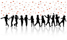 Happy children silhouettes dancing together. Color Stock Photo