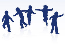Happy children silhouettes dancing together Royalty Free Stock Photography