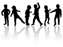 Happy children silhouettes dancing together Royalty Free Stock Photo