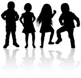 Happy children silhouettes. Girls and boys Stock Photos