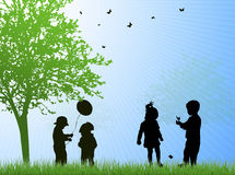Happy children silhouettes outdoors Royalty Free Stock Image