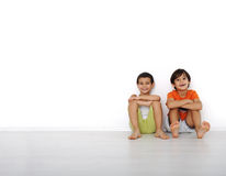 Happy children sitting at home Stock Images