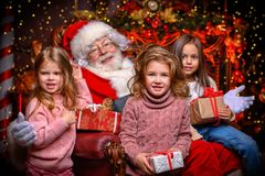 Happy kids with santa stock photography