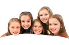 Happy children sitting at a white table Stock Photo
