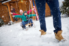 Happy children on sled in winter day -Family vacation. Happy children on sled in winter day on snow-Family vacation Stock Images