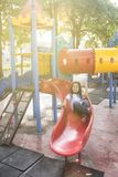 Happy children on slide at playground area Royalty Free Stock Image