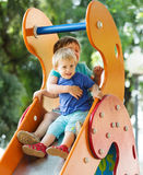 Happy children on slide Royalty Free Stock Image
