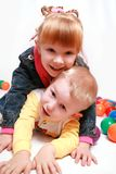 Happy children smiling. Two cute twin sisters having fun Royalty Free Stock Image