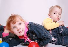 Happy children smiling. Two cute twin sisters having fun Royalty Free Stock Photos