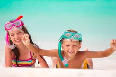 Happy children with snorkels royalty free stock photography