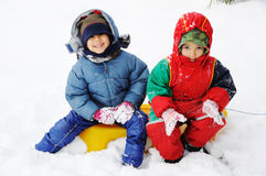 Happy children in snow. Happy two children in snow Royalty Free Stock Photography