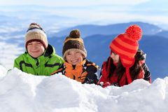 Happy children in snow Stock Photography