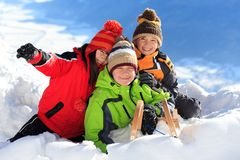 Happy children in snow Stock Photo