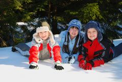 Happy children in snow Stock Photos