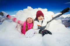 Happy children at snow cave outside in winter time Royalty Free Stock Photos