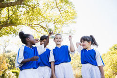 Happy children soccer team celebrating a victory Royalty Free Stock Photo