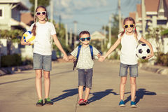Happy children standing on the road Stock Photo