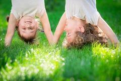 Happy children standing upside down Stock Images