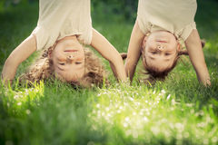 Happy children standing upside down Stock Image
