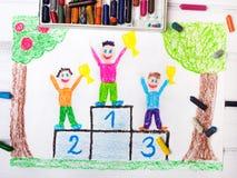Happy children standing on the winner podium Royalty Free Stock Image