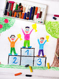 Happy children standing on the winner podium Royalty Free Stock Photos