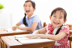 Happy children study in the classroom Stock Photography