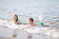 Free Happy Children Swimming In The Sea, Waves And Splashes From Swimming In The Sea Stock Photos - 163265353