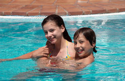 Happy children in swimming pool Stock Photography