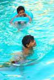 Happy children swimming at Pool. Child swimming at Pool Countryside of Egypt park with Pool royalty free stock photos