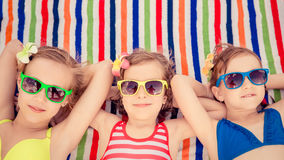 Happy children in the swimming pool. Funny kids playing outdoors. Summer vacation concept royalty free stock photo