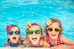 Happy children in the swimming pool stock photos