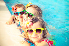 Happy children in the swimming pool royalty free stock photos