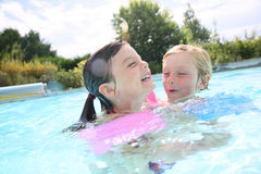 Happy children in swimming pool. Kids playing in swimming-pool royalty free stock photo