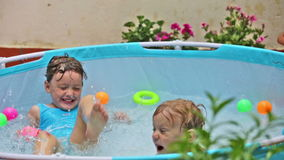 Happy children swimming  in  pool. At  terrace stock video footage