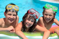 Happy children in swimming pool Stock Photos